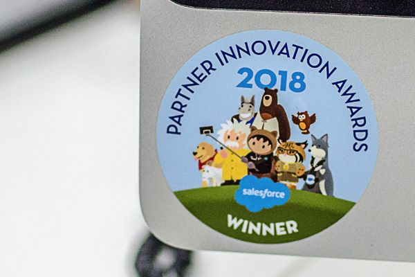 highlight image of a Winner – Salesforce Partner Innovation Awards sticker attached to a monitor