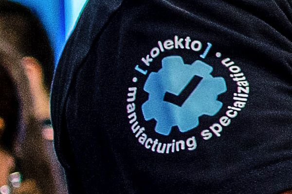 image of a Salesforce Auto & Manufacturing Specialist credential seal on the sleeve of a blue T-shirt